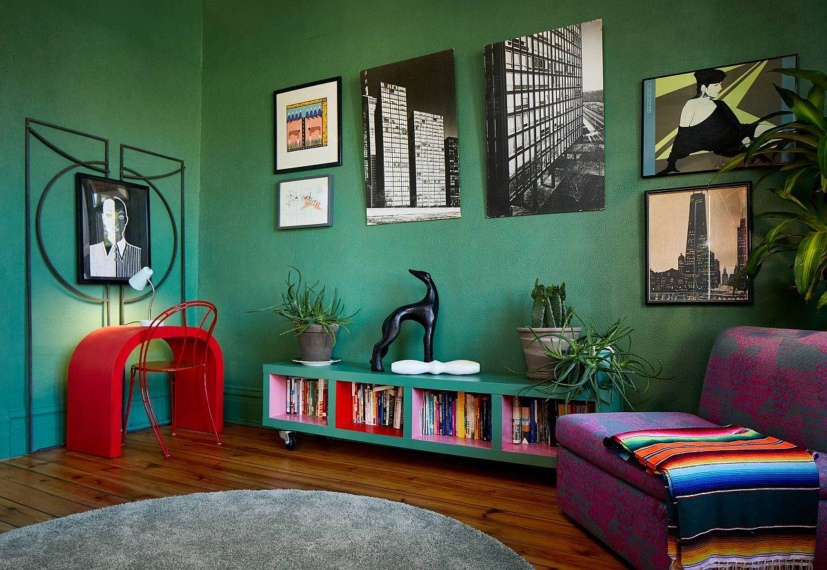 Colorful living room with dark green walls and eclectic décor