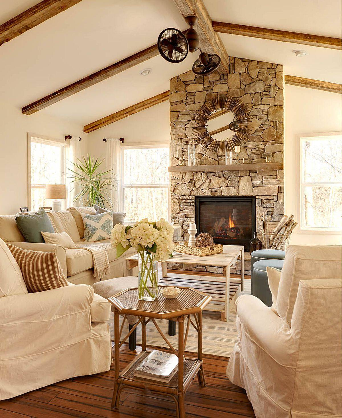 Comfy-farmhouse-living-room-with-warm-neutral-hues-and-stone-fireplace-86493