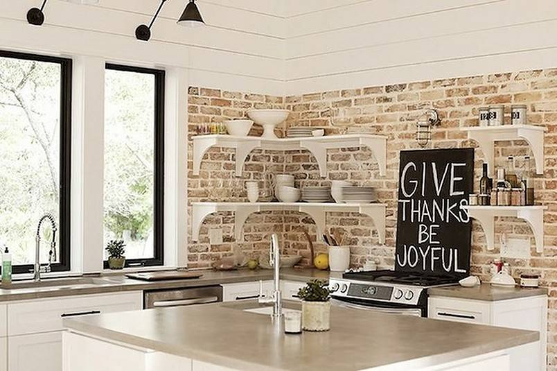 Contemporary kitchen with brick backsplash and white cabinets open shelves