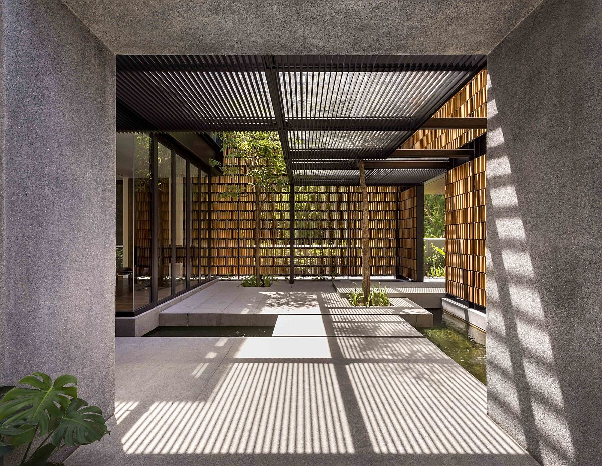 Custom timber screen covering the facade of the home offers ample privacy while allowing in filtered light
