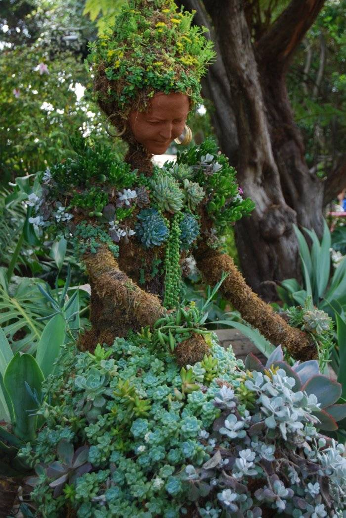 garden sculpture of woman made of terracotta and succulents