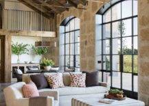 Double-height-farmhouse-style-living-area-with-stone-walls-and-wooden-ceiling-40720-217x155