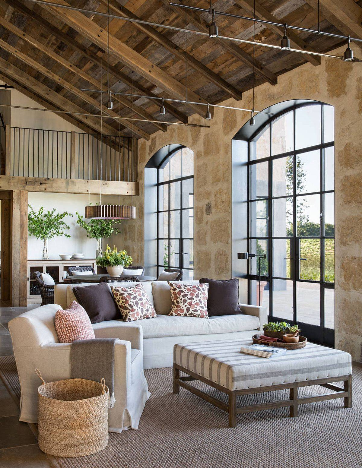 Double-height-farmhouse-style-living-area-with-stone-walls-and-wooden-ceiling-40720