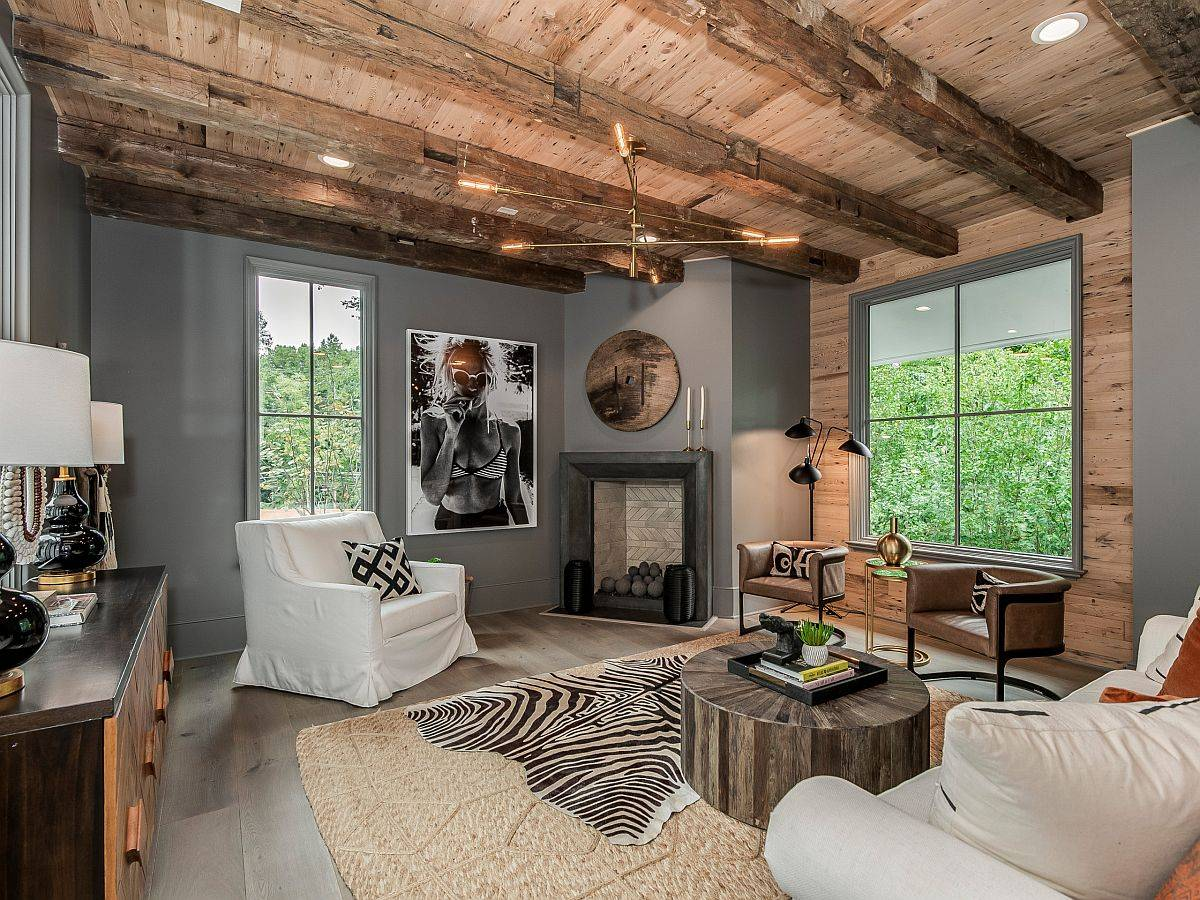 Eclectic modern living room with gray walls and a wooden ceiling