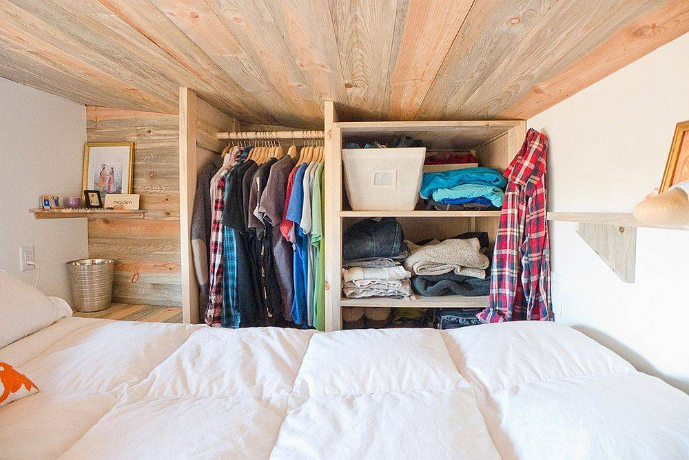 Even the tiny loft bedroom has space for an organized and efficient little closet with the right planning