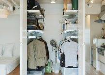 Everything-from-shelves-and-rods-to-boxes-and-crates-is-used-to-shape-this-small-mens-closet-75054-217x155