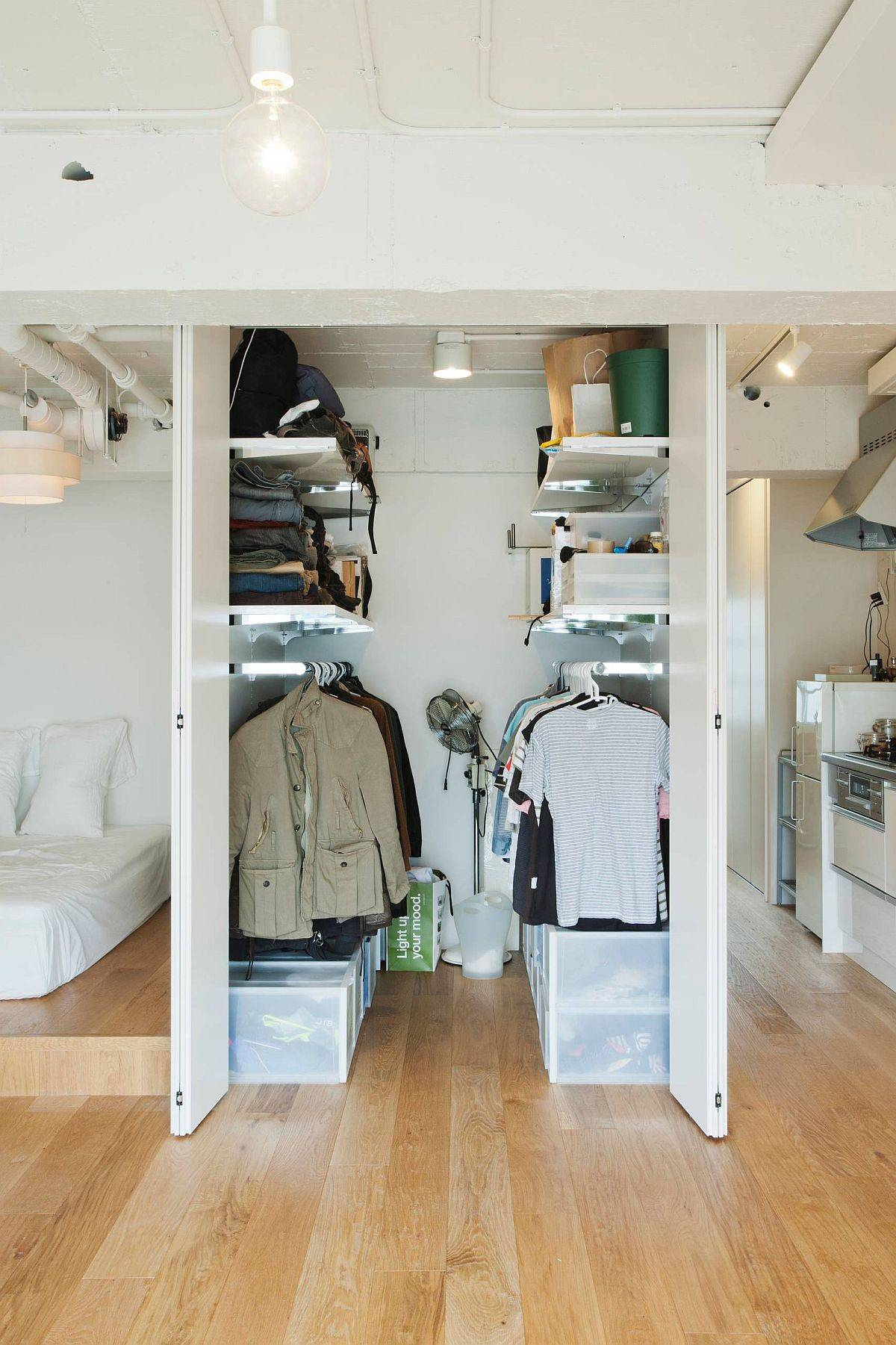 Everything from shelves and rods to boxes and crates is used to shape this small men's closet