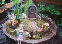 Fairies relaxing in miniature fairy garden