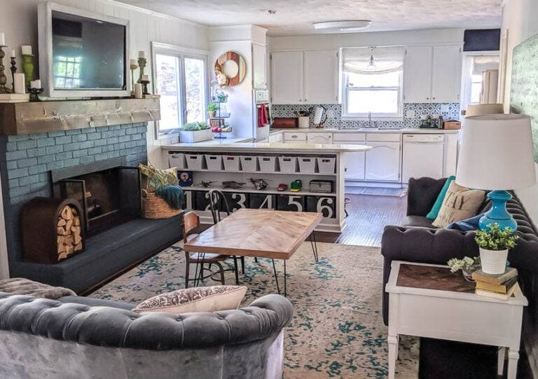 teal painted fireplace in living room