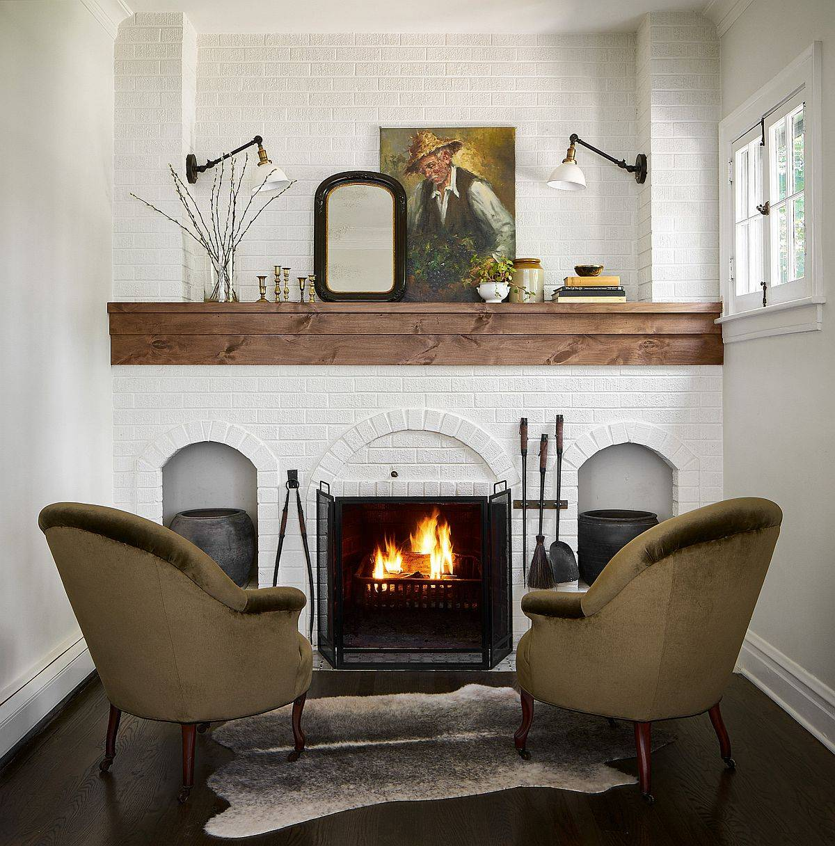 Fireplace becomes the focal point of this small English cottage style living room