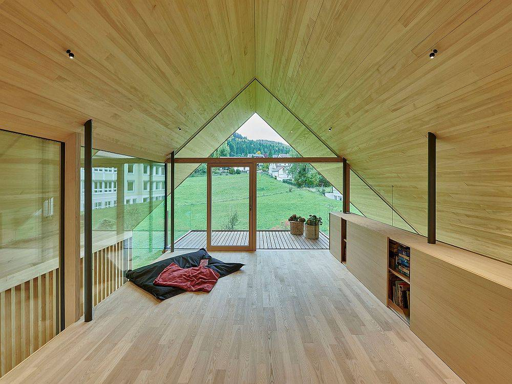 Gabled A-frame of the house create a lovely private studio on the upper level