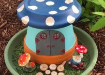 Gnome with a mushroom gnome house