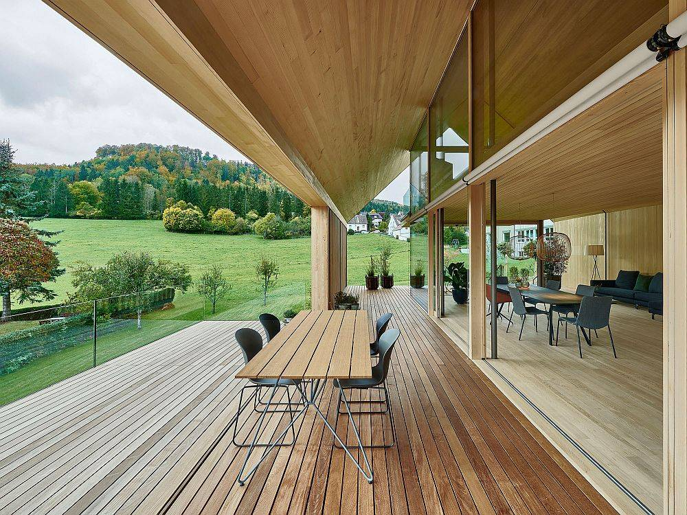 Gorgeous views of lush green landscape and distant hills from the wooden deck outside