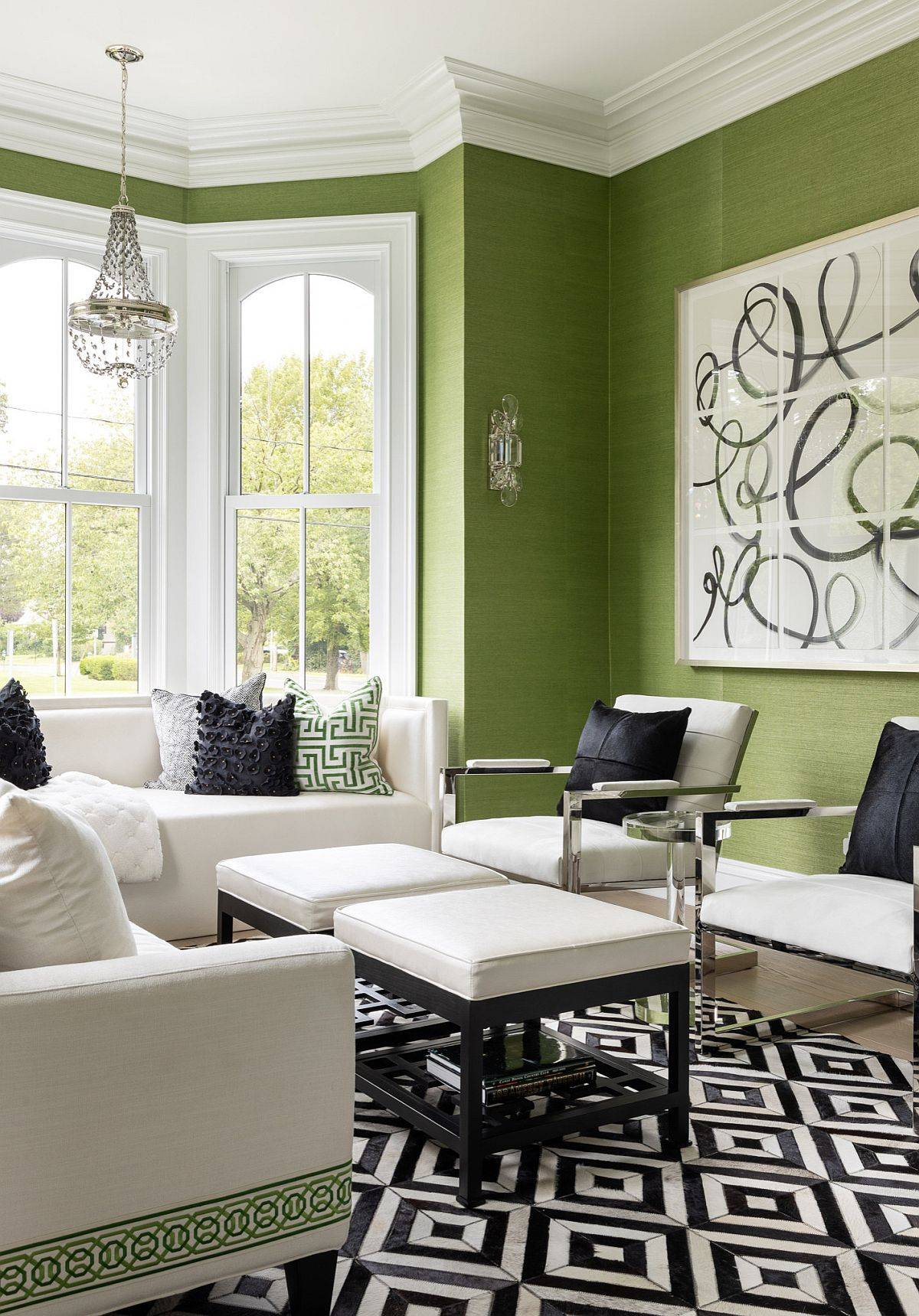 Grasscloth wallcovering in green for the spacious living room with white trims