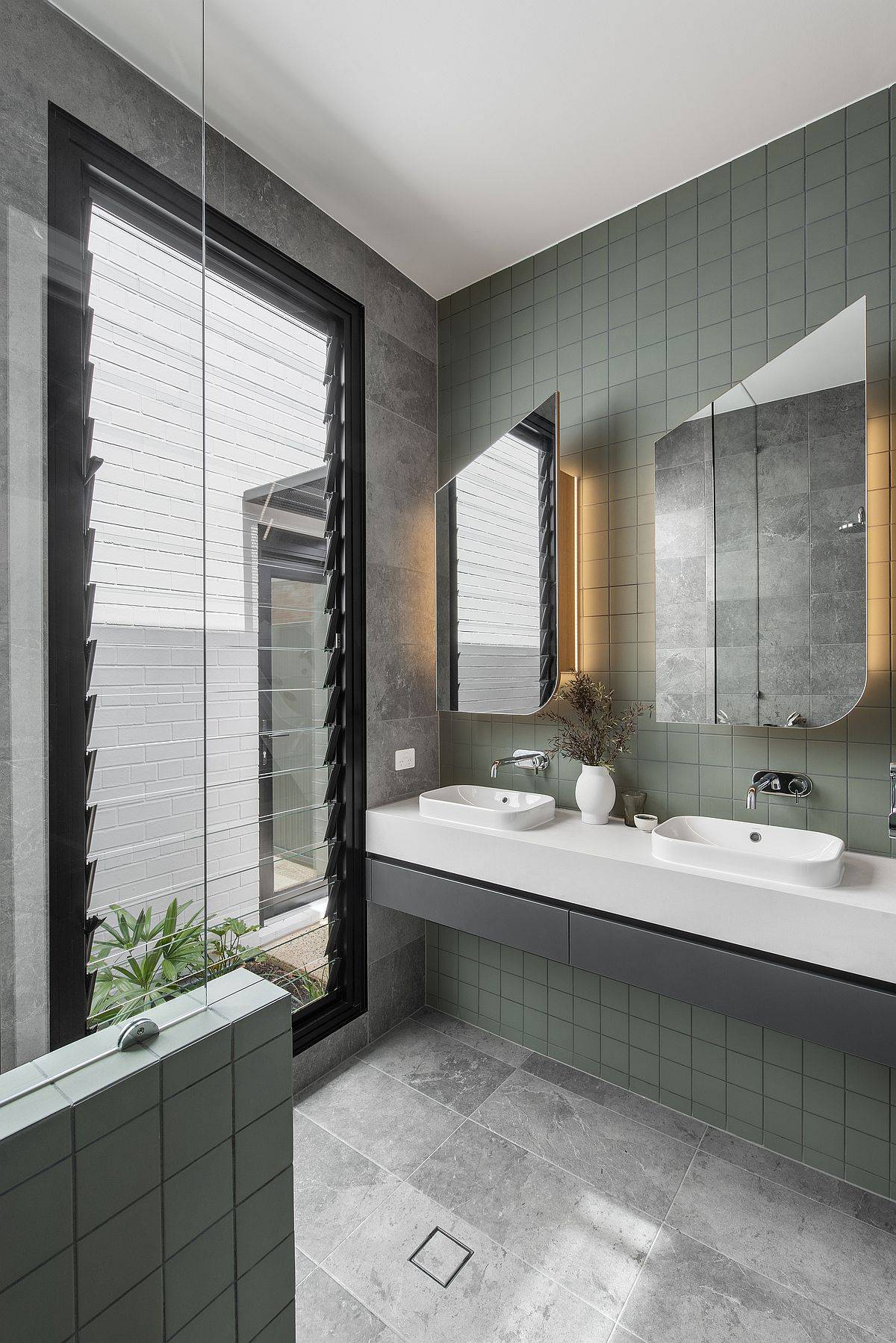 Green tiles for the contemporary bathroom with ample natural light
