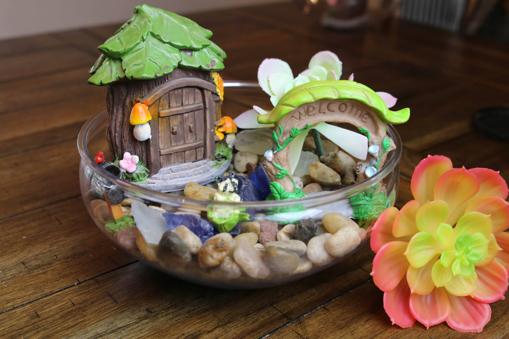 House and pebbles inside a clear glass