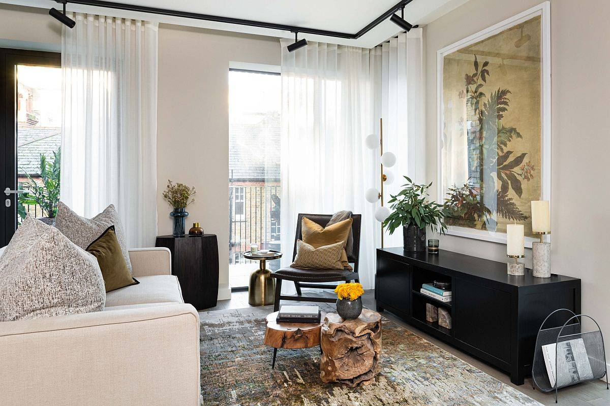 It is the natural coffee table that steals the spotlight in this fabulous contemporary apartment living room in beige