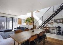 Light-filled-living-area-and-dining-room-of-the-home-in-white-gray-and-wood-26766-217x155