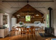 Light fixture hanging from ceiling above wooden table