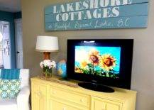 Living room with DIY chalk paint media console reclaimed wood sign.v1