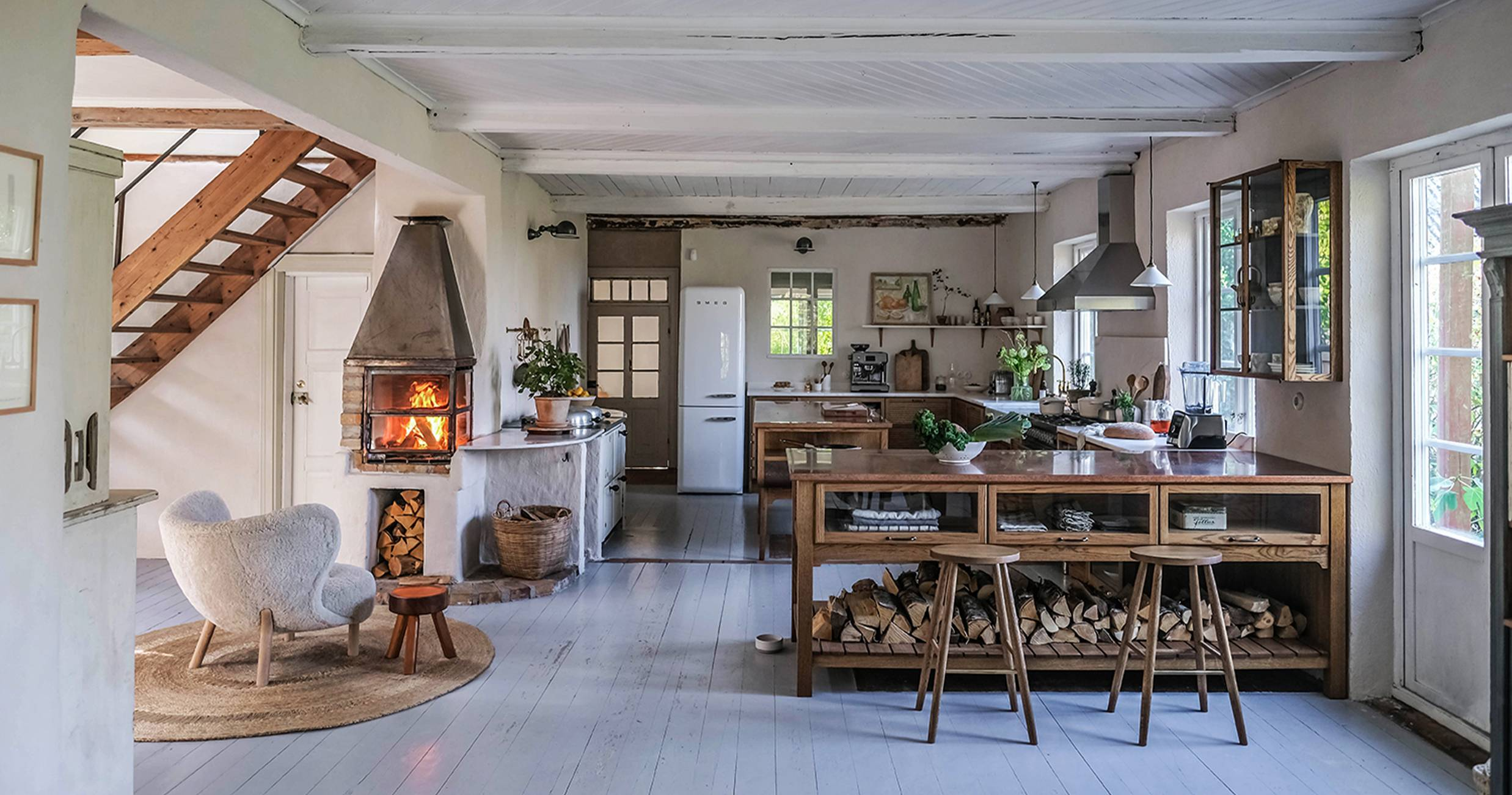 Logs under kitchen counter and metal fire pit