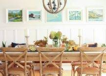 Long wood table with plants and candles at the center
