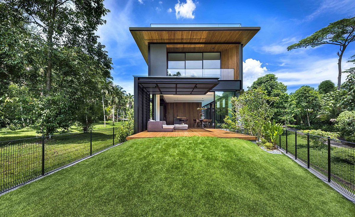 Lush green state land surrounds the rear section of the home