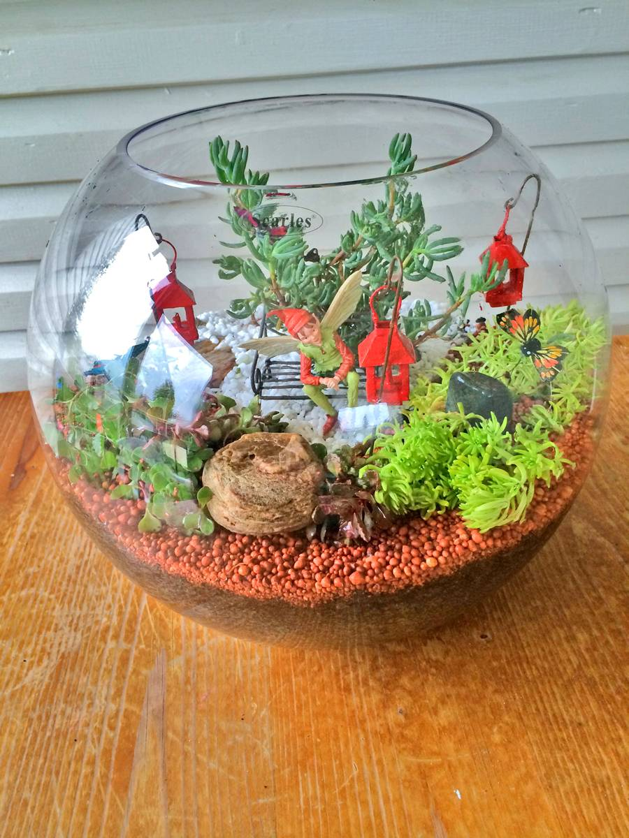 Miniature Terrarium Fairy Garden finished in a large round glass fish bowl