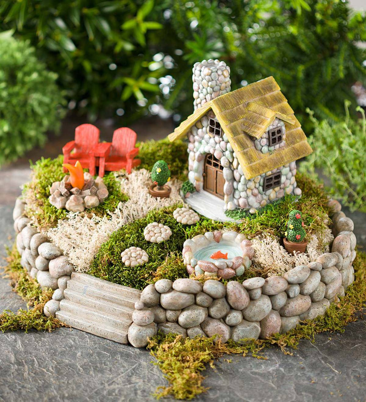 Miniature fairy garden with pebbles