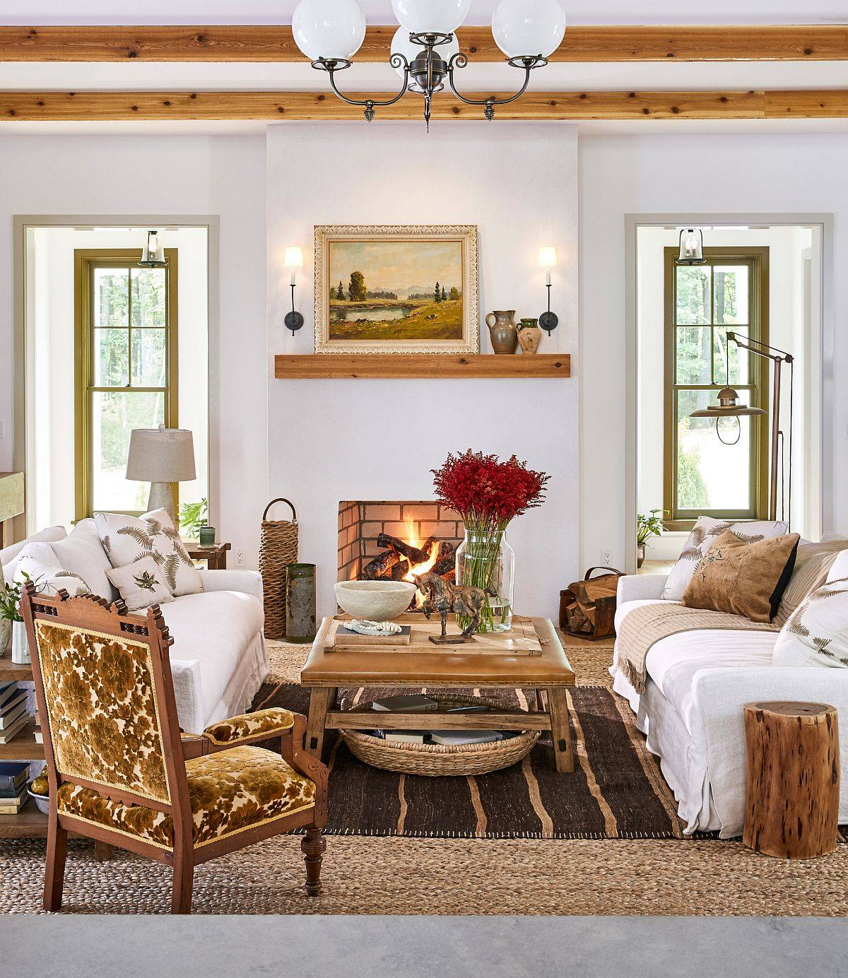 Modern-farmhouse-style-living-room-in-white-with-fireplace-wooden-beams-and-cozy-decor-40605