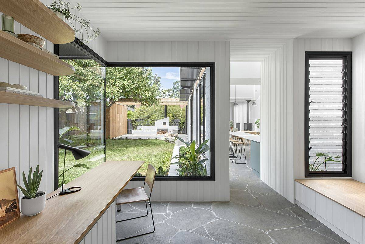 Modern home office in wood and white with a view of the garden
