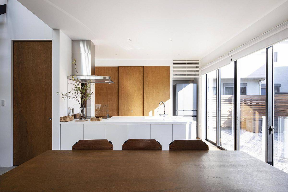 Modern kitchen and dining area with sliding glass doors