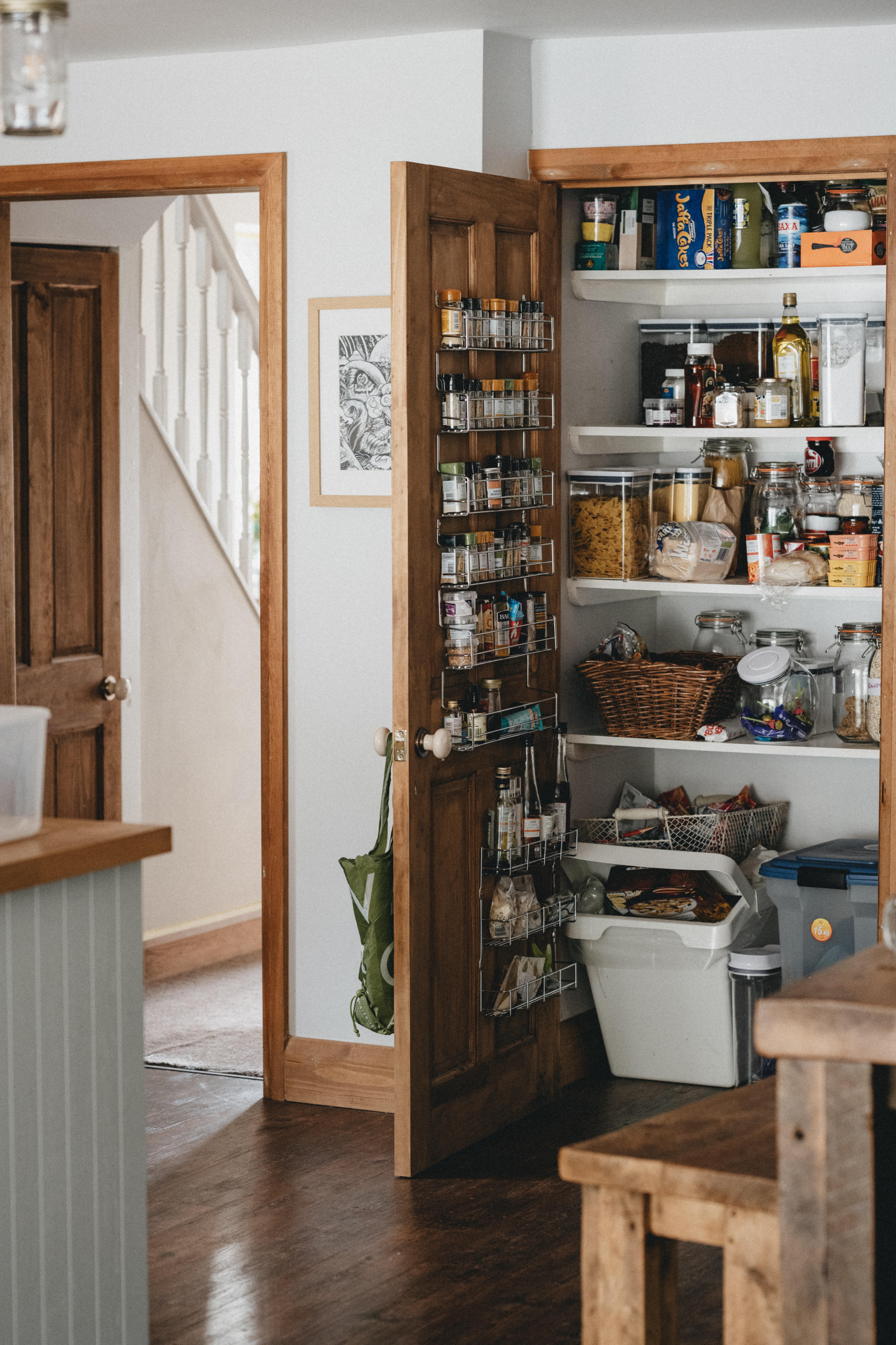 Open pantry door with spice rack