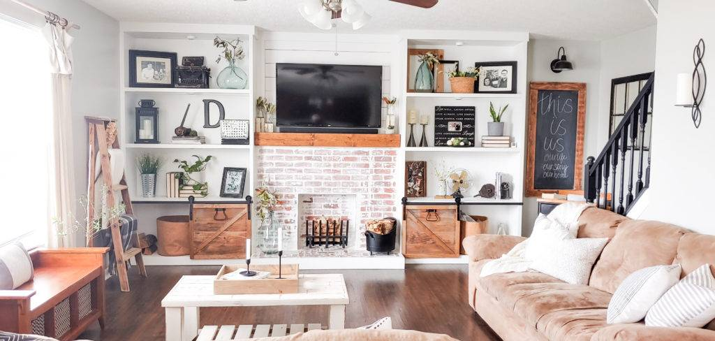 brick faux fireplace with wooden mantel