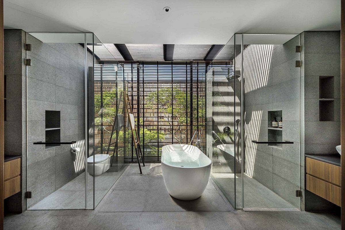 Polished contemporary bathroom in gray with glass walls and a fabulous white bathtub