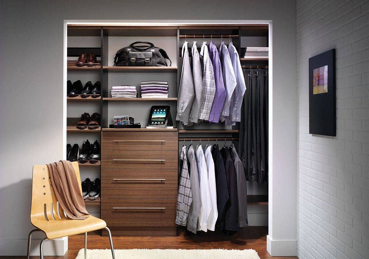 Polished contemporray small men's closet design with wooden shelves and ample storage space