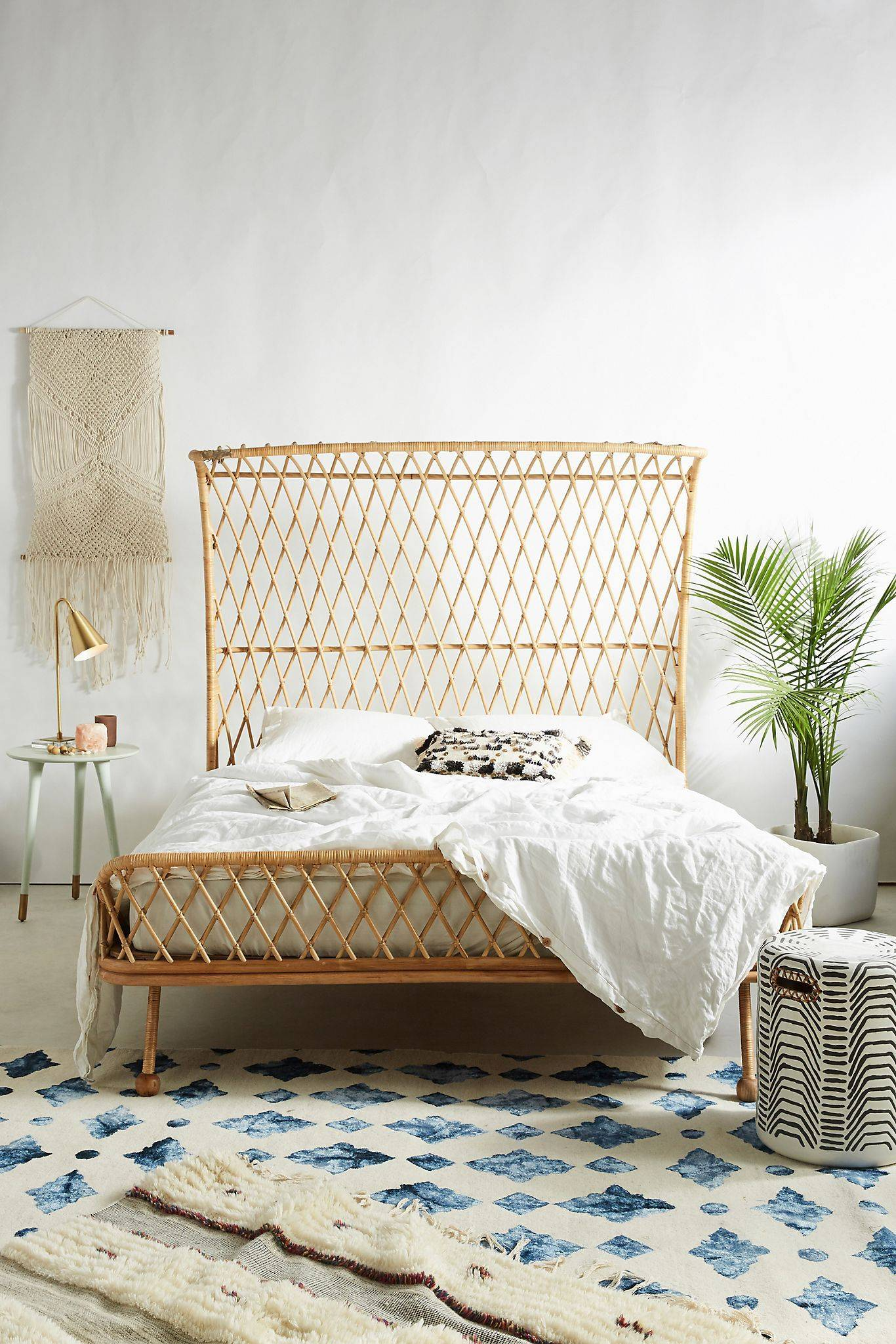 Rattan bed with potted plant on the side