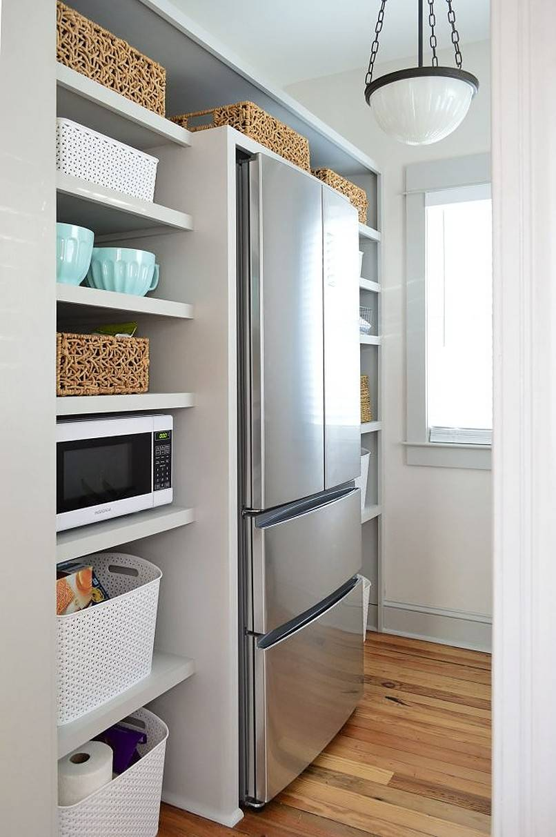 Refrigerator surrounded by shelves