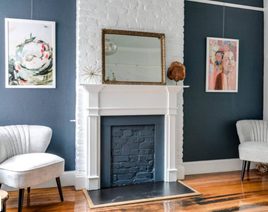 blue painted brick faux fireplace with white mantel