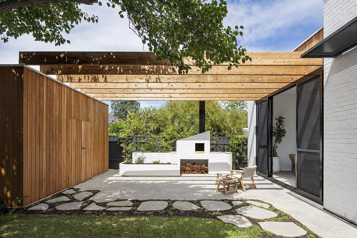 Sheltered entrance of the Aussie home with wooden screen and custom wooden beams