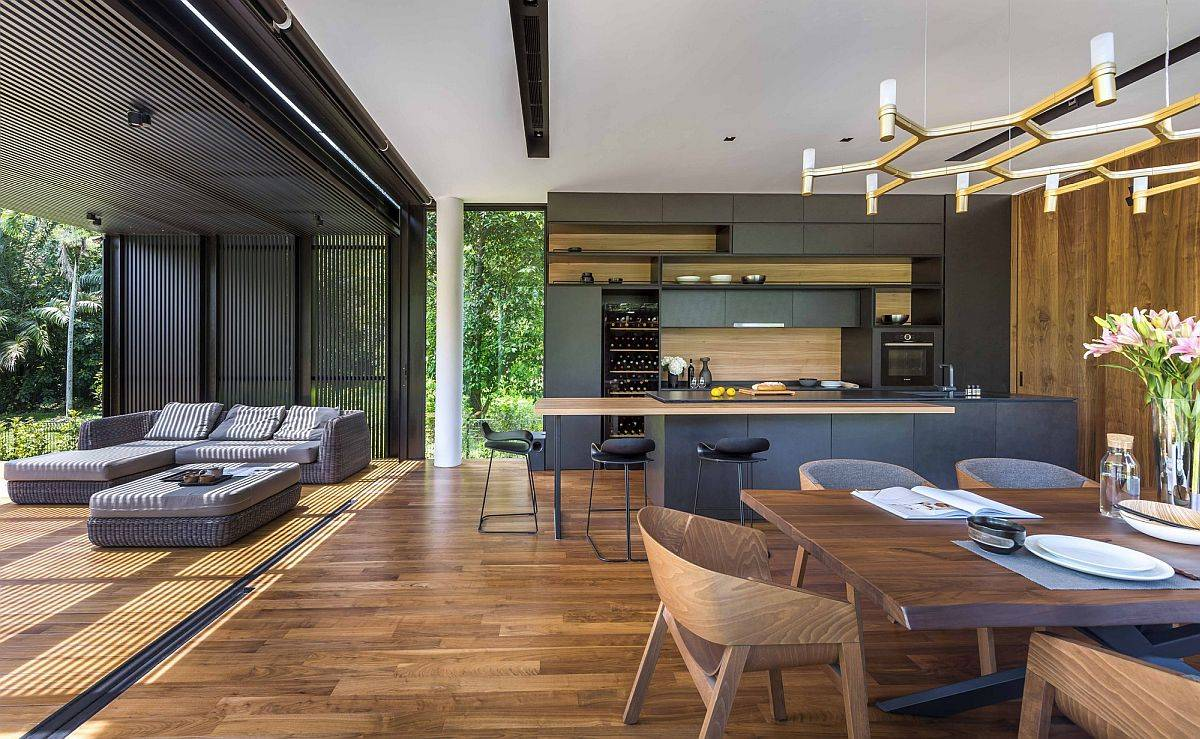 Sliding glass doors open up the new living area towards the deck and the green outdoors