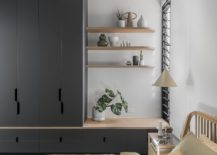 Small-and-space-savvy-modern-bedroom-in-white-with-dark-gray-cabinets-29566-217x155