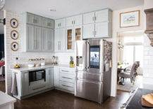 Small kitchen area with large fridge