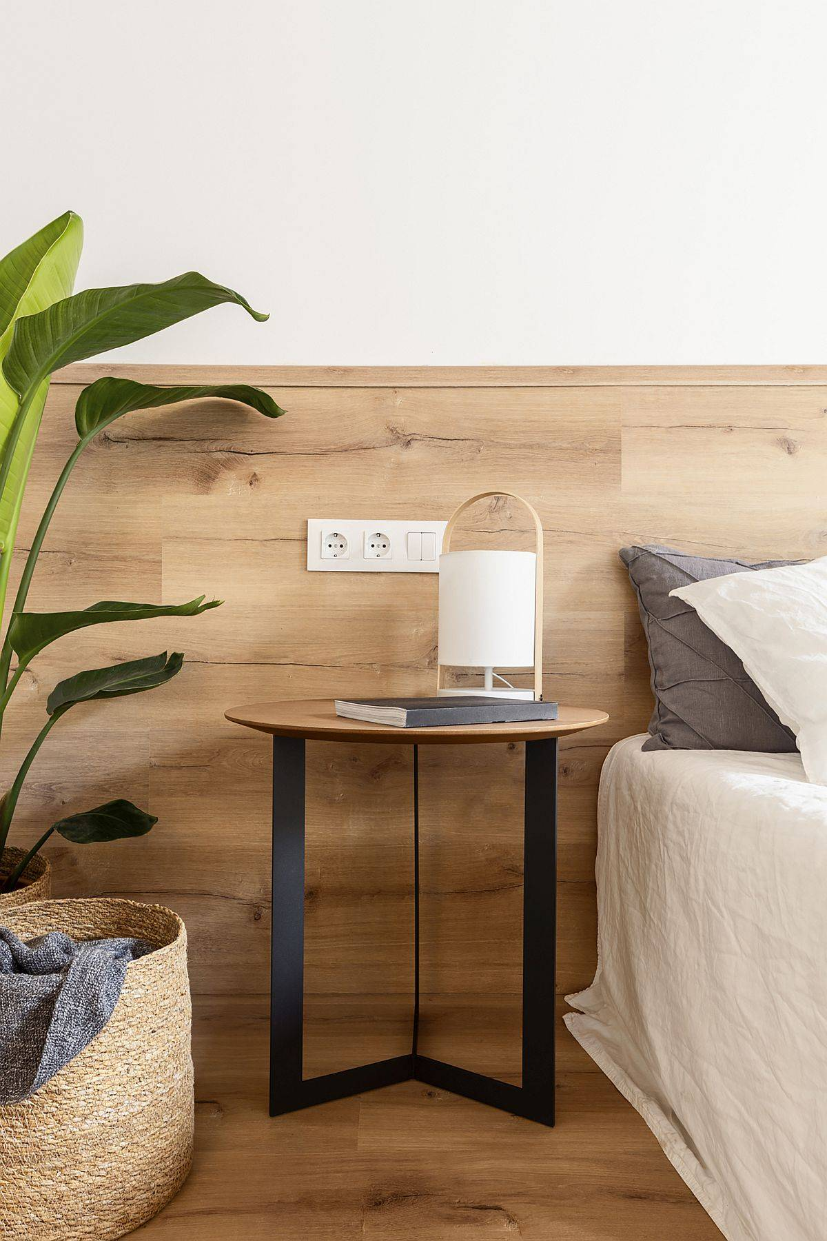 Small wooden bedside table for the modern Scandinavian style bedroom