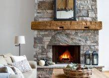 Stone-fireplace-becomes-the-focal-point-in-this-gorgeous-farmhouse-style-fireplace-31453-217x155