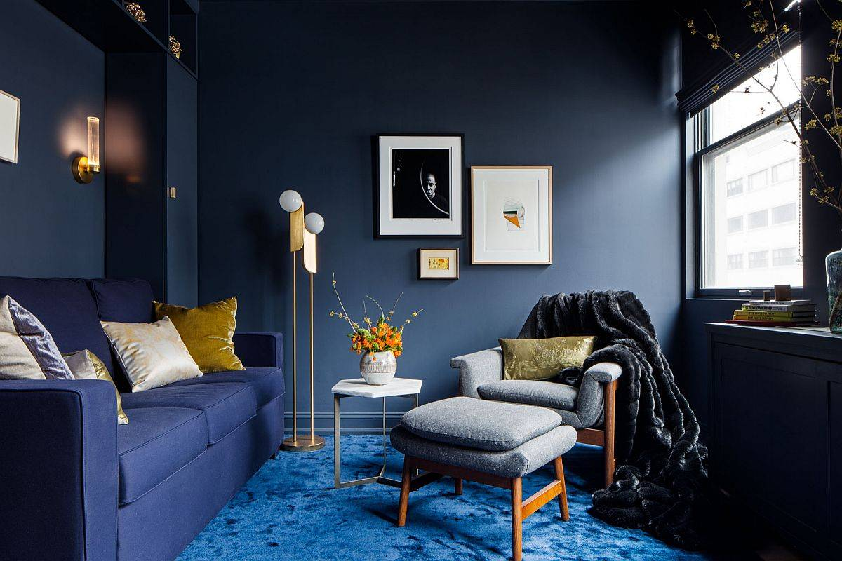 Stunning contemporary living room with dark bluish gray walls, blue carpet and dark blue sofa is an absolute visual treat