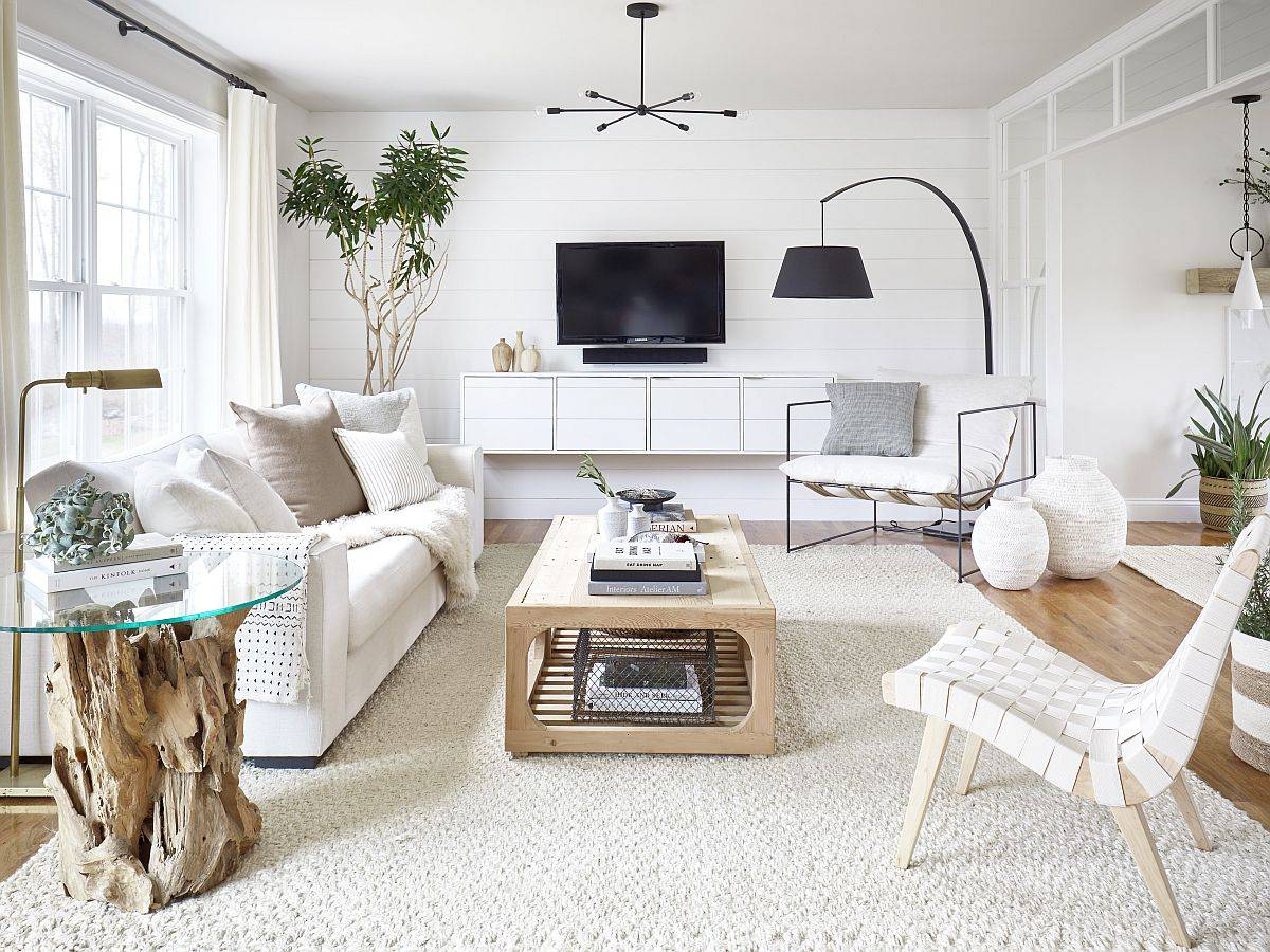Stylish modern living room in white and wood with ample natural light