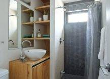 Tiny-bathroom-with-space-savvy-design-and-a-wooden-vanity-75296-217x155