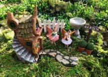 Two fairies beside a house