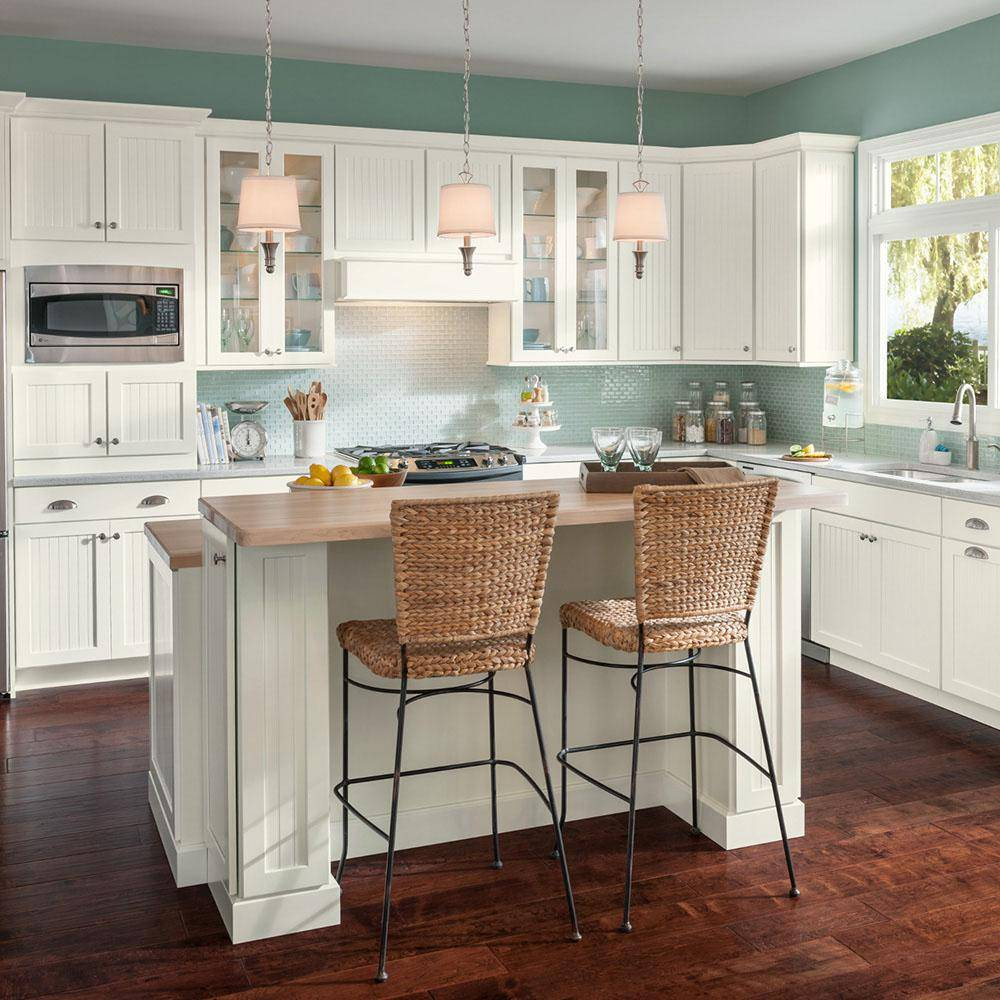 Two highrise chairs facing kitchen counter
